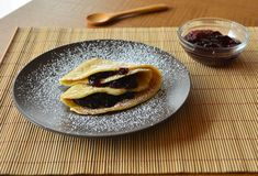 Homemade pancakes with jam and icing sugar. Royalty Free Stock Photo