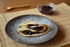 Homemade pancakes with jam and icing sugar. Stock Photos