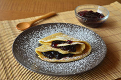 Homemade pancakes with jam and icing sugar. Royalty Free Stock Images