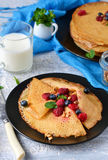 Homemade pancakes with milk for breakfast. On a concrete background Royalty Free Stock Photo