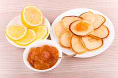 Homemade pancakes with peach jam and lemon Stock Photos