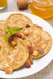 Homemade pancakes with peaches and honey for breakfast, vertical Stock Photo
