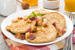 Homemade pancakes with peaches and honey Stock Photo