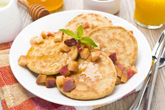 Homemade pancakes with peaches and honey, top view Royalty Free Stock Photography