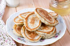 Homemade pancakes with poppy seeds for tasty healthy breakfast stock photos