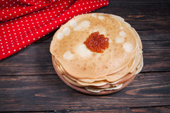 Homemade pancakes with Red caviar on wood Stock Images
