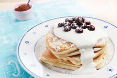 Homemade pancakes. Stack of pancakes with yoghurt and cherries Stock Images