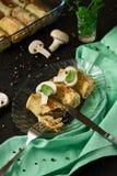 Homemade pancakes stuffed mushrooms. On dark wooden background Stock Image