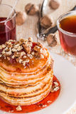 Homemade pancakes with walnuts and strawberry jam Stock Image