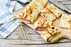 Pancakes. Homemade pancakes  with  yellow cheese and ham Stock Photography