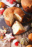Homemade panettone bread with dried fruit and Christmas decorati Stock Photo