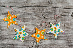 Homemade paper Christmas garland on a  wooden surface. Stock Images