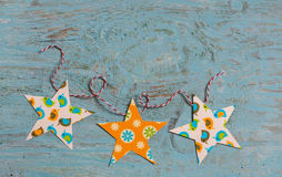 Homemade paper Christmas garland on a  wooden surface. Free space for text Royalty Free Stock Photo