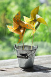 Homemade paper pinwheel in vintage bucket Stock Image