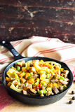 Homemade pappardelle pasta dish with pumpkin, avocado, chili pepper and pork meat Royalty Free Stock Images