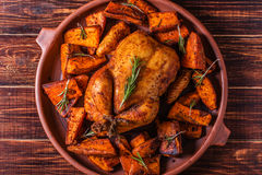 Homemade Paprika and Herb Whole Chicken with spices Sweet Potato stock image