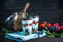 Homemade parfait with fresh fruit and cream. On wooden background Stock Image