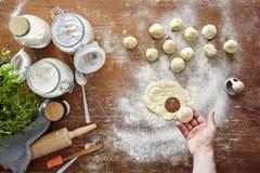 Homemade pasta atmopsheric kitchen hand cutting out ravioli Royalty Free Stock Image