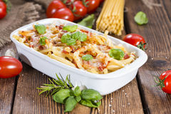 Homemade Pasta Bake. Portion of homemade Pasta Bake (with Macaroni) on wooden background Stock Photography