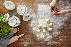 Homemade pasta baking in kitchen hands forming dough Royalty Free Stock Images
