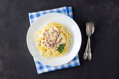 Homemade Pasta carbonara on white plate royalty free stock image