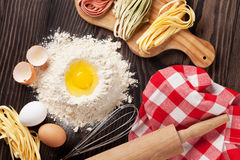 Homemade pasta cooking. On wooden table. Top view Royalty Free Stock Photography