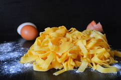 Homemade pasta on the eggs Royalty Free Stock Photography
