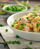 Homemade Pasta fusilli with salmon, green peas, parmesan cheese and lemon. close up. healthy food stock photos