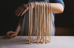 Homemade pasta on hand Royalty Free Stock Photo