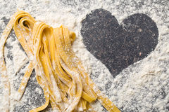 Homemade pasta and heart. The homemade pasta and heart Stock Photography