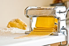 Homemade pasta maker with dough Stock Image