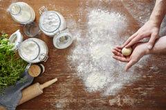 Homemade pasta making hands preparing the dough Royalty Free Stock Photo