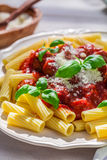 Homemade pasta penne with tomato sauce and parmesan Stock Images