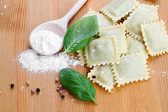 Homemade pasta ravioli with fresh basil, Stock Image