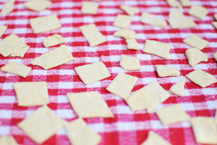 Homemade pasta. On red and white tablecloth Stock Photography