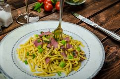 Homemade pasta with roasted Black Forest ham Stock Photo