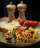 Homemade pasta with seafood and cherry tomatoes Royalty Free Stock Photo