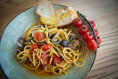 Homemade pasta with seafood and cherry tomatoes Royalty Free Stock Photography