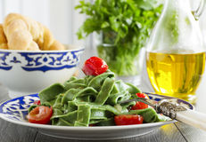 Homemade pasta. With spinach and tomatoes Stock Image