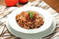 Homemade pasta topped with tomato and Parmesan integral Stock Images