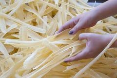 Homemade pasta in woman hands Stock Photos