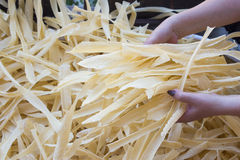 Homemade pasta in woman hands Royalty Free Stock Images