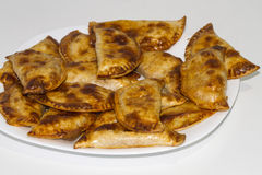 Homemade pasties. On white plate Royalty Free Stock Photography