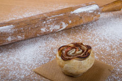 Homemade pastries on a light wooden table with flour Royalty Free Stock Photography
