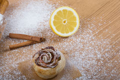 Homemade pastries on a light wooden table with flour Royalty Free Stock Photo