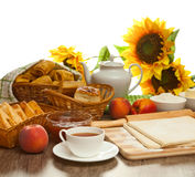Homemade pastry puff pastry. Appetizing pies from flaky pastry are on the wooden table, submitted with a fresh fruits, jam of peaches and tasty tea for breakfast Stock Photos