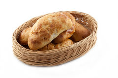 Homemade pasty. In wicker basket on white background Royalty Free Stock Photo