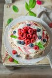 Homemade Pavlova dessert with raspberries, meringue and raspberry mousse. On old table Royalty Free Stock Images