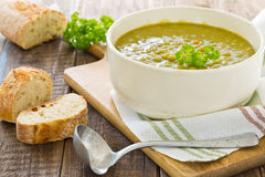 Homemade pea soup with bread Royalty Free Stock Image