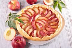 Homemade peach cake. And fruit Royalty Free Stock Image